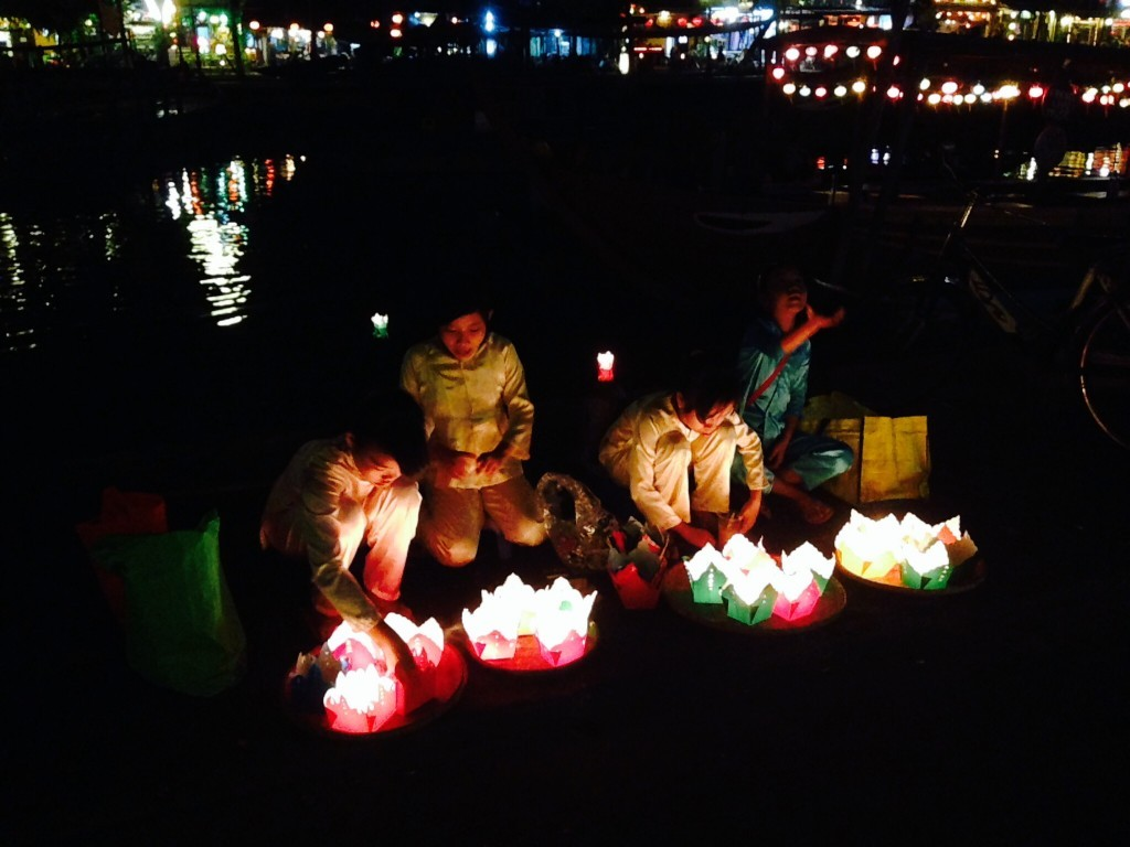 Kids selling floating lanterns- plastic or paper container with a candle inside. Suppose to bring lots of luck.